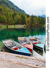 Beautiful Lago di Fusine the mountain lake at boat and...