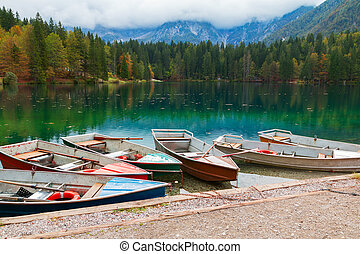 Beautiful Lago di Fusine the mountain lake at boat and...