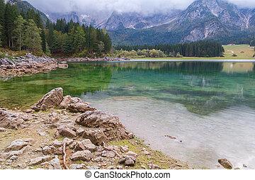 Beautiful Lago di Fusine the mountain lake and Mangart...