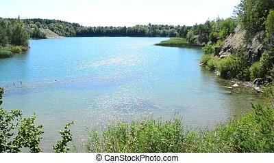 Beautiful lake and light blue water in summer - Beautiful...