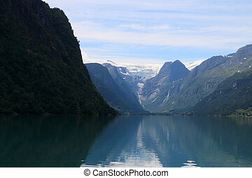 beautiful lake at briksdalsbreen in norway