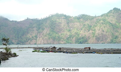 Beautiful Lake Batur full of square submerged bamboo cages...