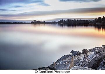 Beautiful lake coast during sunrise