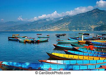 Beautiful lake - Colorful boats on Fewa lake, Pokhara, Nepal