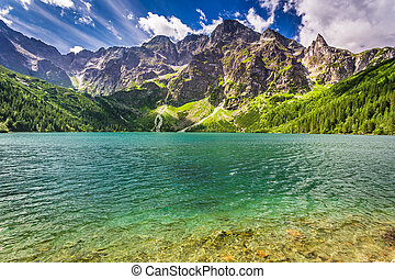 Beautiful lake in the Tatra Mountains at sunrise