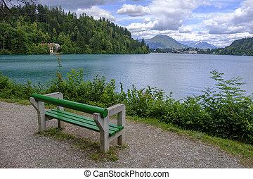 Beautiful lake with bench.