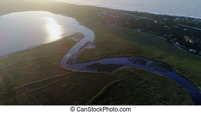 Beautiful landscape along the sea at sunrise 4k - Aerial of...