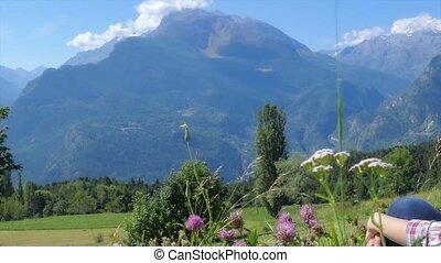 beautiful landscape - beautiful blond girl sitting in a...