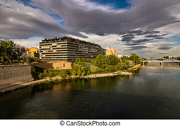 landscape in a spring day over the city bridge and the Ebro river in the Spanish city of Zaragoza