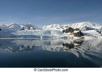Beautiful landscape in Antartica in morning light. Some snow covered mountains.