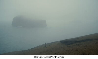 Beautiful landscape in Iceland. Young woman walking on the...