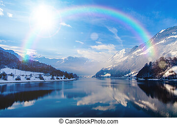 beautiful landscape in winter with rainbow