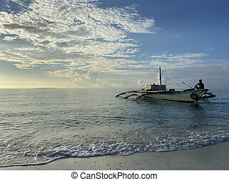 Beautiful landscape of a boat with a fisherman in the foreground in the sea background a blue sky with porous clouds.