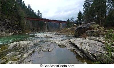 beautiful landscape of bridge over mountain river