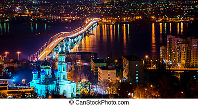 beautiful landscape of evening city Saratov with church and bridge through the Volga River, Russia, panorama
