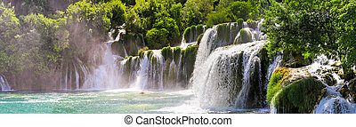 Beautiful landscape of Krka waterfalls surrounded by forest