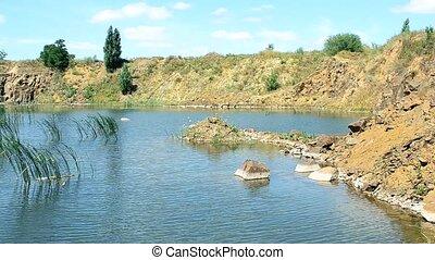 Beautiful landscape of lake in summer with basalt rocks,...