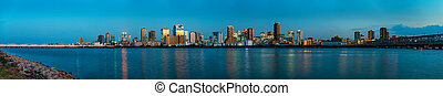beautiful landscape of Osaka city with modern buildings and river, Japan, sunset, panorama