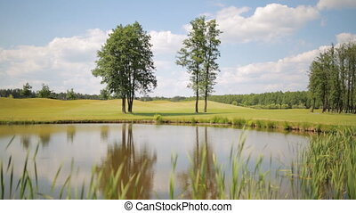 Beautiful landscape of pond on the golf field