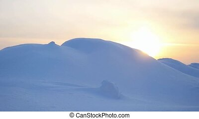 Beautiful Landscape of snowy mountain peak on amazing sunset Adventure Winter Travel in slow motion.