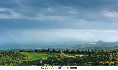 Beautiful landscape of Tuscany with floating clouds, timelapse