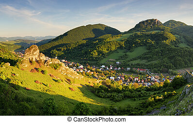 Beautiful landscape of valley in Slovakia mountains, small houses in village, rural scene, majestic picturesque view at sunset panorama