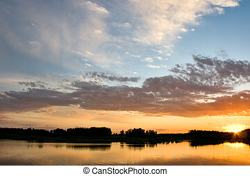 beautiful landscape with forest and lake in sunset