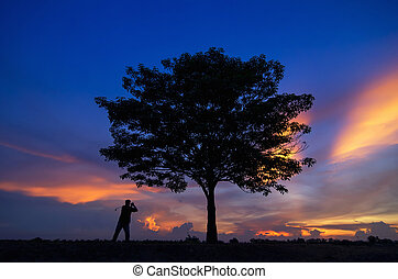 Beautiful landscape with Golfer silhouette.