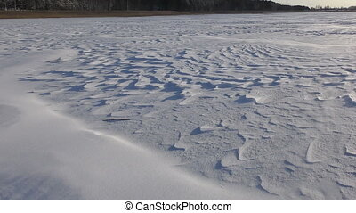Beautiful landscape with snowy relief surface and strong...