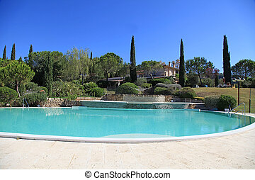 Beautiful landscape with the swimming pool, Tuscany, Italy