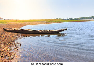 beautiful landscape with wooden boat on the river