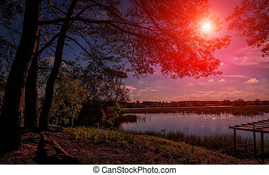 beautiful landscape. wonderful autumn evening. sky with majestic clouds over the lake in the forest breathtaking scenery.