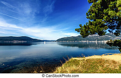 Beautiful lanscape of Boka bay with Lustica Peninsula and Porto Montenegro in the background