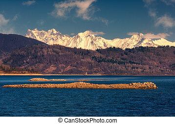 late autumn view of caucasus mountains in Georgia, Shaori lake