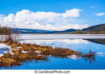 late winter image of mountains and a lake