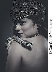 beautiful latin woman with python snake