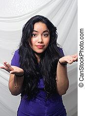 Beautiful Latina Shrugging her Shoulders