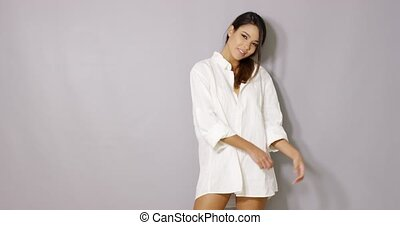 Beautiful latina woman posing isolated on gray background....