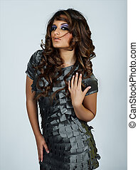 beautiful latino woman with long curly hair
