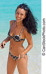 Beautiful laughing woman in a bikini