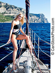 Beautiful leggy blonde on yacht - Beautiful blonde woman...