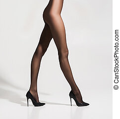 Beautiful legs in hosiery over white background