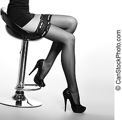 Beautiful legs in nice stockings over white background -...