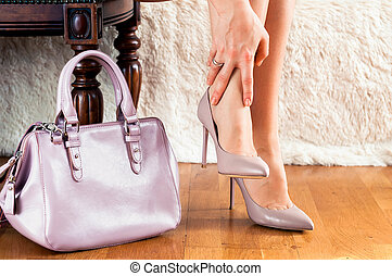 Beautiful legs woman with hand bag pain in the legs, fatigue, treatment, medicine