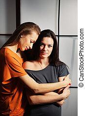 Beautiful lesbian flirting couple in the studio.
