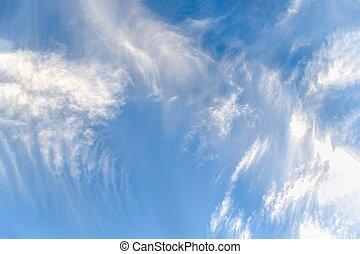 Beautiful light blue sky with blurred cirrocumulus clouds