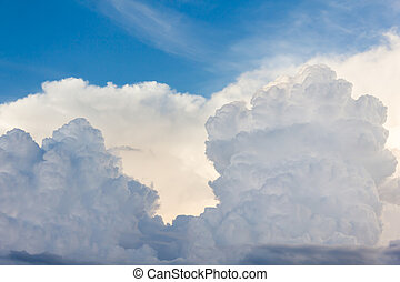 Beautiful light blue sky with puffy white clouds in happy...
