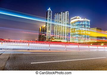 beautiful light trails of city traffic at night