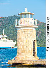 beautiful lighthouse on the background of mountains in the resor