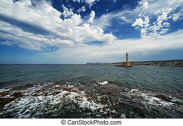 Beautiful lighthouse over blue cloudy sky